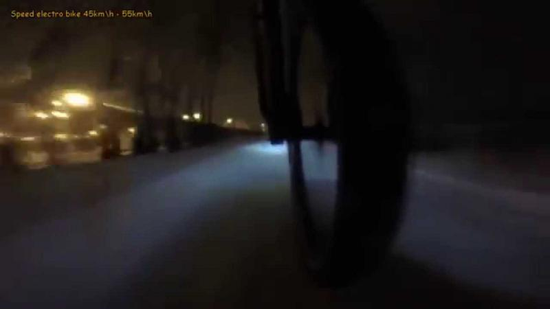 Winter electric bike in russian. Snowy bypass road in Moscow MKAD.