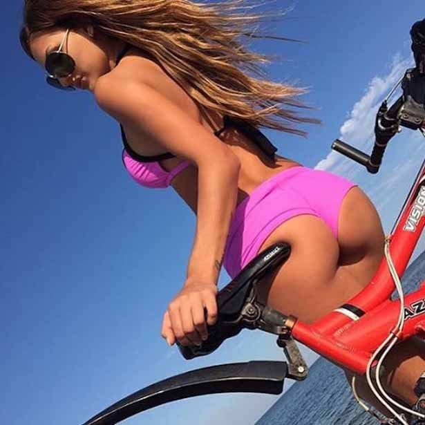 Sexy Girl In Shorts Riding A Bicycle Rear View Vector Image