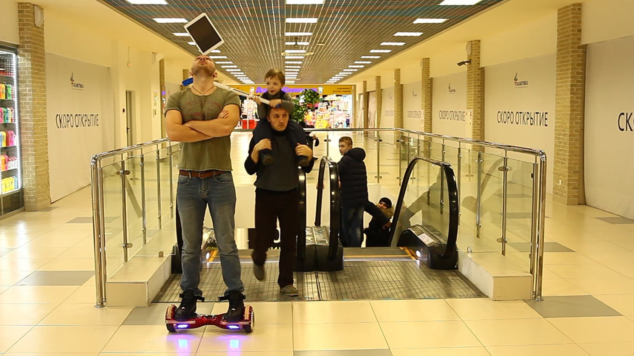 Мальчик разбил iPad. Holding the iPad's the balance, he rides a Hoverboard.