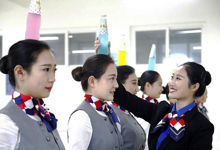 Суровые тренировки китайских стюардесс китай, стюардесса, тренировки