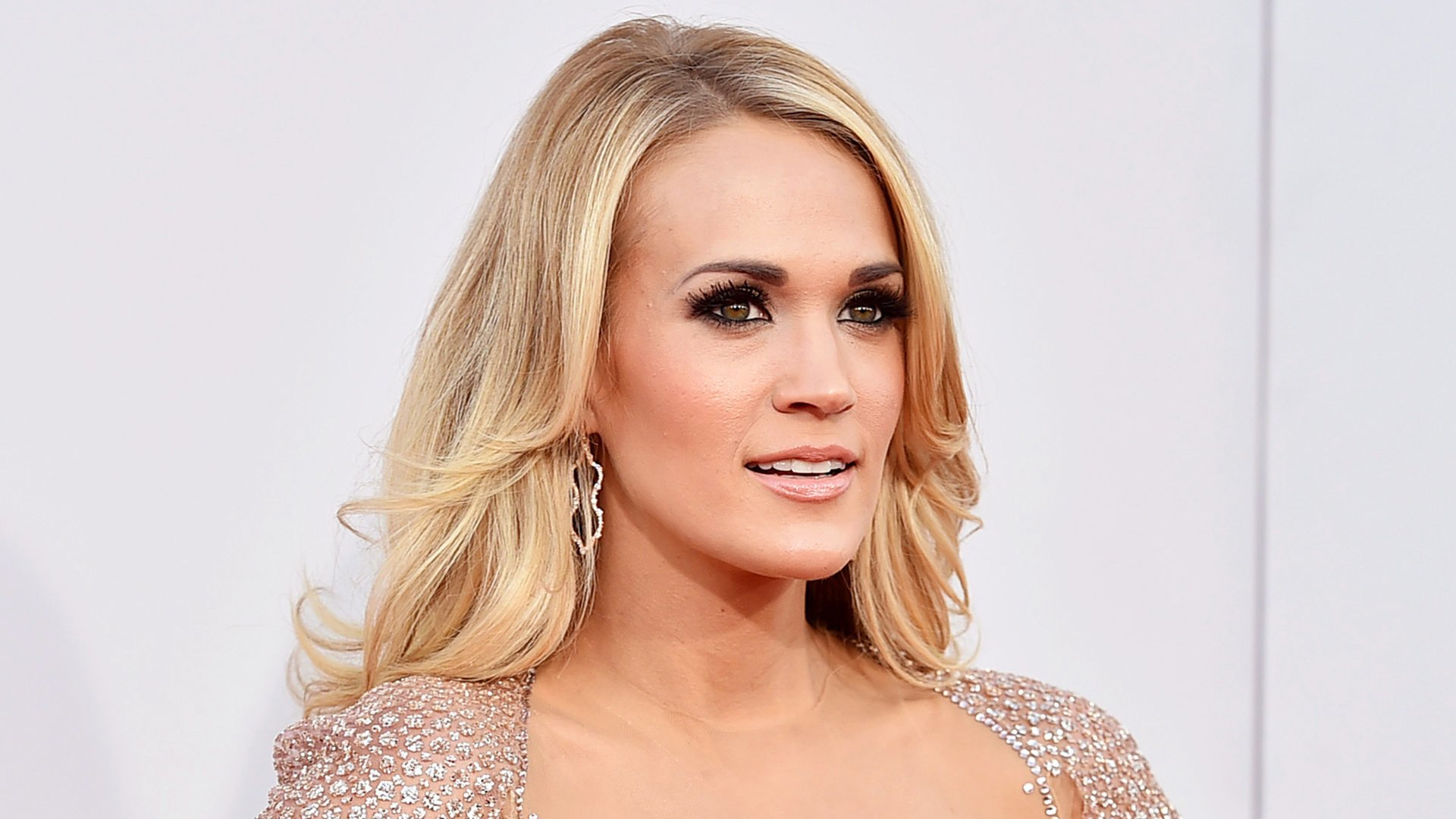 Carrie Underwood does not need to save her marriage to Mike Fisher because its not in crisis mode despite a new report Gossip Cop can correct this