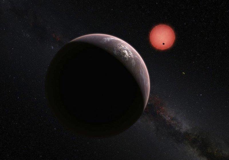 Воображаемый вид на три планеты, вращающиеся вокруг ультра-холодного карлика в 40 световых годах от Земли космос, красота, планета, рисунки, художники