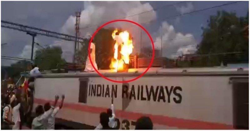 Участник забастовки получил сильнейший удар током на крыше поезда видео, индия, крыша, поезд, слабоумие и отвага, удар током, электричество