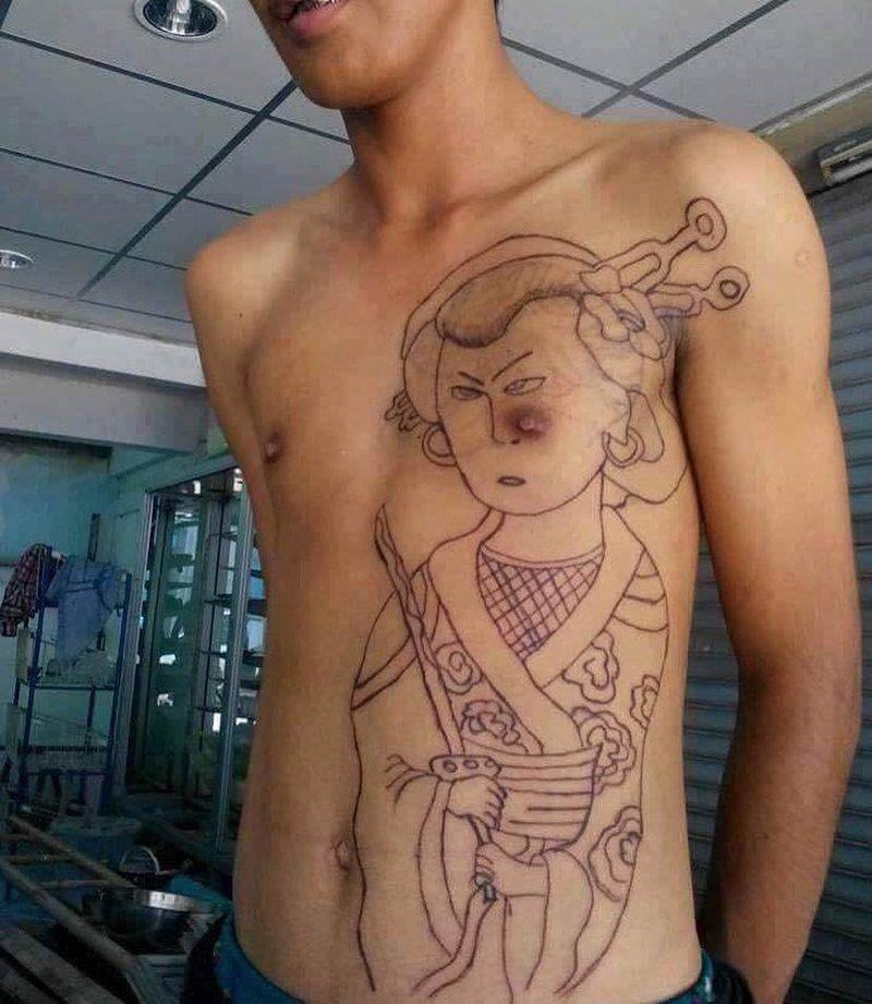 12. Предполагалось, что это будет тату в японском стиле, но что-то пошло не так. абсурд, ошибка, плохое качество, страх, тату, татуировка