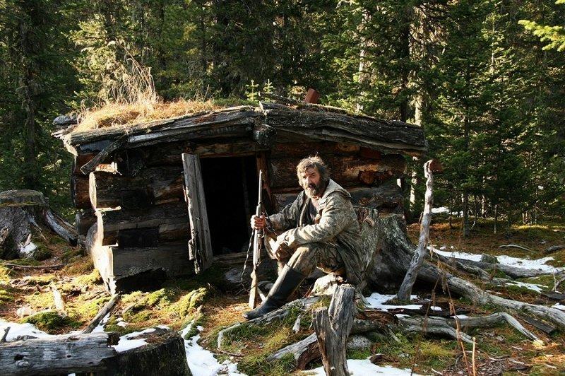 попробовал охотничий домик фото в тайге распознать