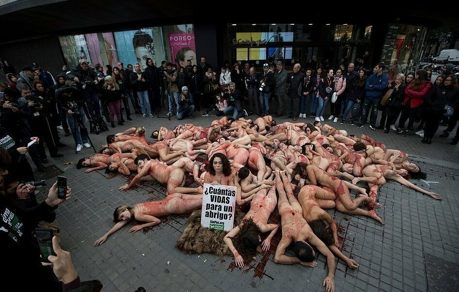 girl-kiss-hundreds-of-people-strip-against-fur-industry-girls-babes-sexy
